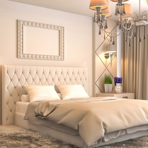 master bedroom with custom upholstery and bed linens